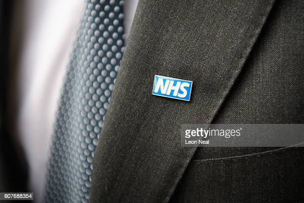A man wears an NHS pin badge as junior doctors and supporters rally outside the Royal Courts of Justice Strand on the first day of their hearing as...
