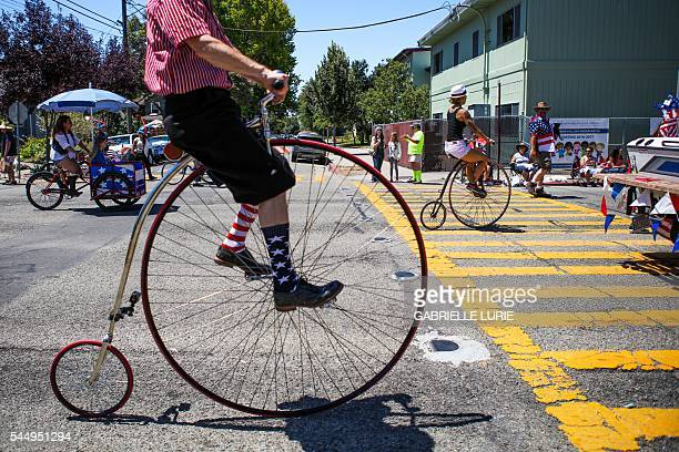 TOPSHOT A man wears decorative socks while riding a vintage bicycle during the 4th of July Parade in Alameda California on Monday July 4 2016 / AFP /...
