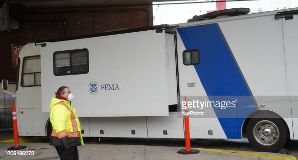 Man wears facemask next to FEMA van at Pier 90 where The US Naval Hospital Ship Comfort docked at Manhattan, New York, US on March 30, 2020.