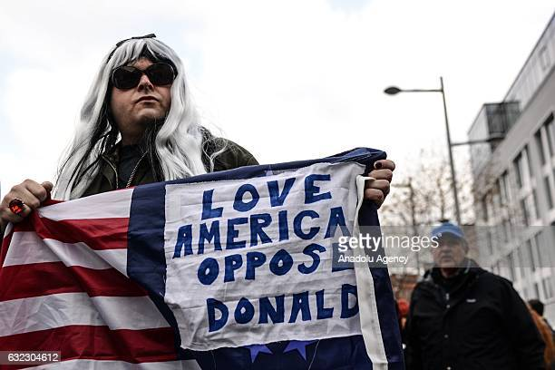A man wears fake hair and holds placard during a protest held in solidarity with the Washington DC Women's March in Dublin Ireland on January 21 2017