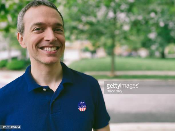 """man wears """"i voted"""" sticker - midterm election stock pictures, royalty-free photos & images"""