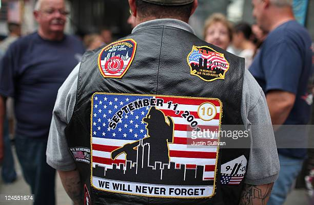 A man wears patches on his vest in honor of New York Fire Department firefighters who died in the September 11 terror attacks on September 10 2011 in...
