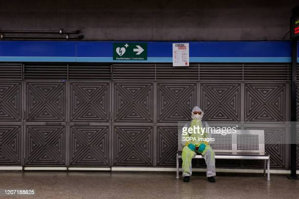 Man wears protective clothing and face mask as a preventive measure against the coronavirus in a metro station. Spain has declared the state of...