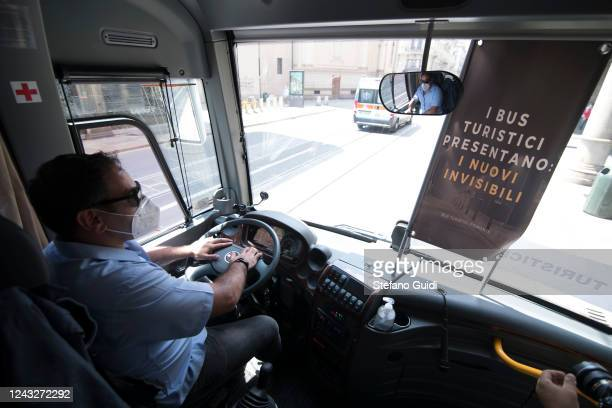 Man wears protective mask drive a tourist buses in the streets of the center of Turin during the demonstrators protest of Bus Drivers against the...