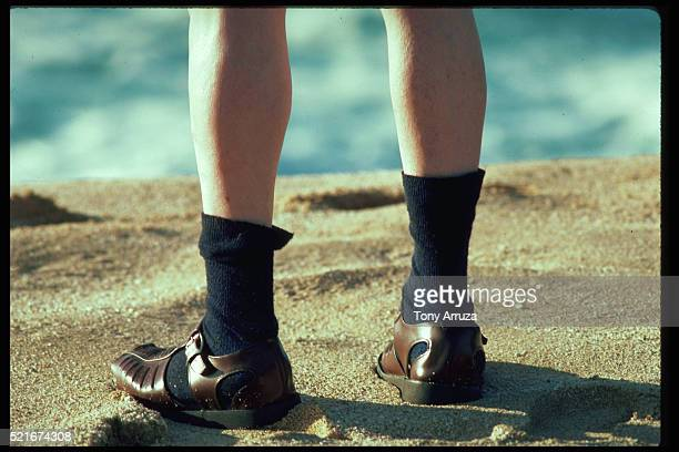 Man Wears Sandals and Socks