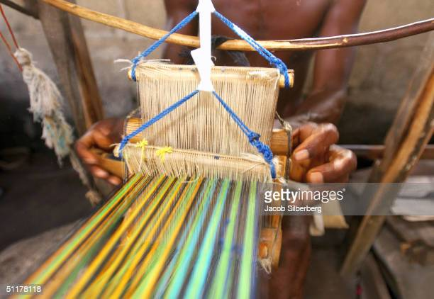 A man weaves Kente cloth in eastern Ghana May 13 2004 Ghana is the most tourist friendly country in Anglophone West Africa boasting warm and friendly...