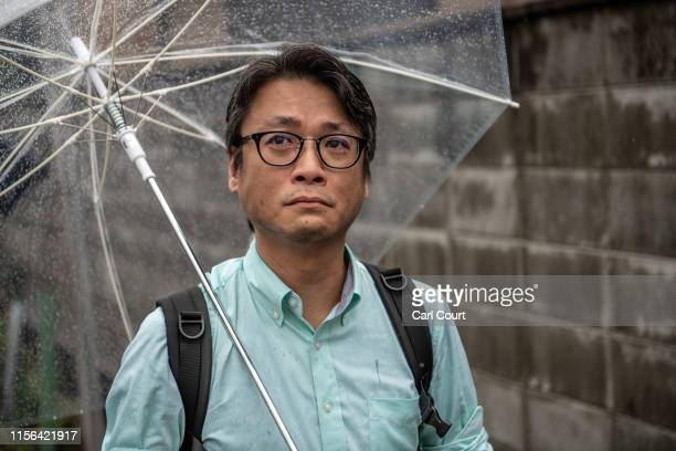 A man weeps as he pauses near the Kyoto Animation Co studio building after it was attacked by an arsonist on July 19 2019 in Kyoto Japan Thirty three...