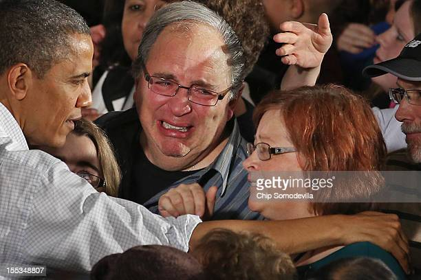 Man weeps as U.S. President Barack Obama greets supporters after addressing a campaign rally in the main gymnasium at Mentor High School November 3,...