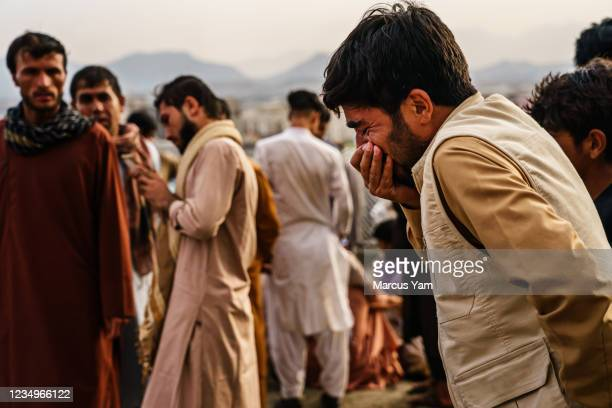 Man weeps during a mass funeral for members of a family was killed in a U.S. Drone airstrike, in Kabul, Afghanistan, Monday, Aug. 30, 2021.