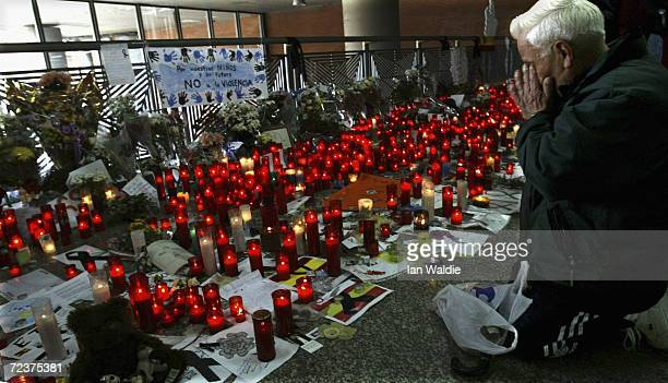 A man weeps near a mass of red candles at Atocha train station as a memorial for those killed in the terrorist bombings March 13 2004 in Madrid Ten...