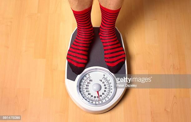 Man weighing himself