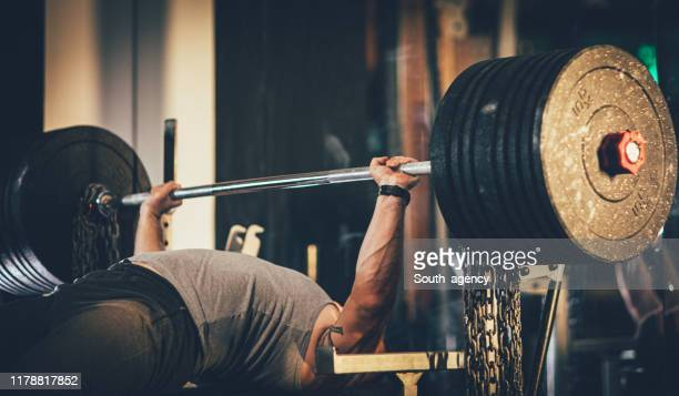 man weightlifter at the gym - south_agency stock pictures, royalty-free photos & images
