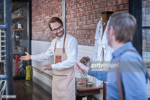 Man welcoming customer on a factory tour