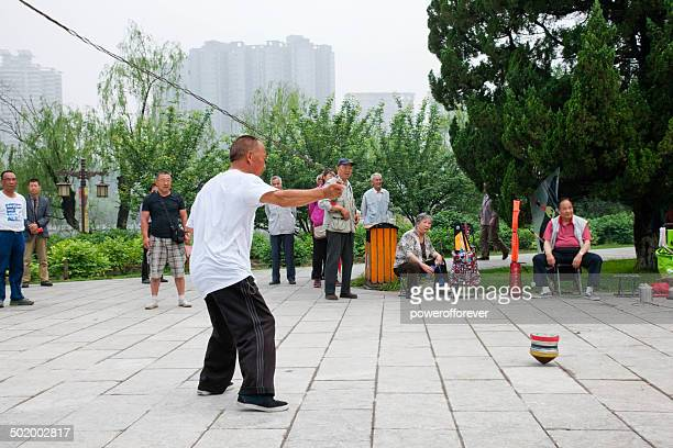 Man Whipping a Top in Xianqing Park