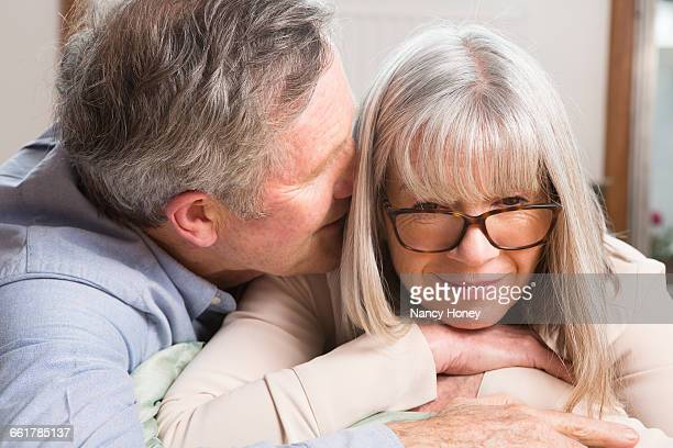 Man whispering into wifes ear