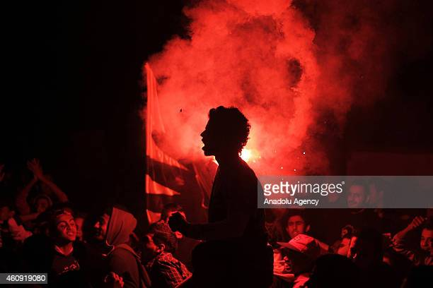 A man who calls himself anticoup demonstrator holds flares as they hold a 'Rabia Day' in memory of AbdulRahman Hasan a Cairo University student who...