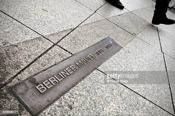 Man who crosses Berlin Wall sign