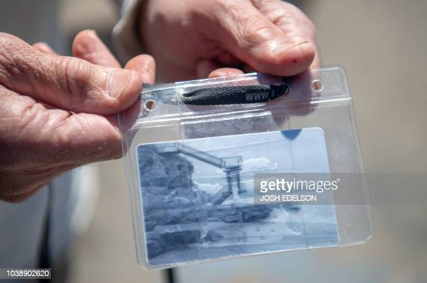 A man who declined to give his name displays an access card he uses to enter Privates Beach in the Opal Cliffs area of Santa Cruz California on...