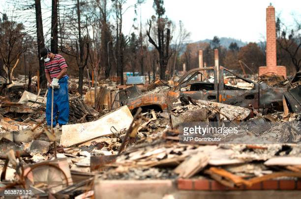 A man who declined to give his name surveys a burned property in the Coffey Park area of Santa Rosa California on October 20 2017 Residents are being...