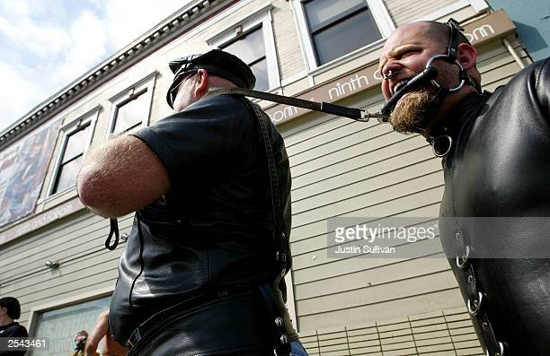 A man who did not want to be identified by name pulls his slave Ricky at the 20th Annual Folsom Street Fair September 28 2003 in San Francisco...