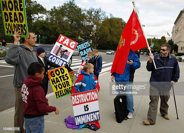 A man who did not want to be identified drags a US Marine Corps flag across the face of Westboro Baptist Church member Fred Phelps Jr son of pastor...