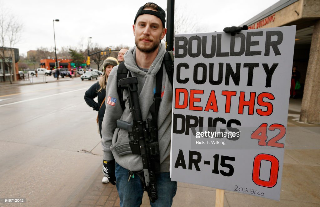 A man who didn't want to be identified carries his Noveske N4 300 Blackout AR-15 pistol at a pro gun rally on April 21, 2018 in Boulder, Colorado. The city of Boulder is considering enacting an ordinance that will ban the sale and possession of assault weapons in the city.