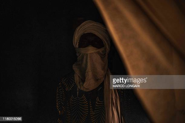A man who fought alongside Jihadists in Central Mali and that has now left his former group poses in an undisclosed location on July 7 2019 where he...