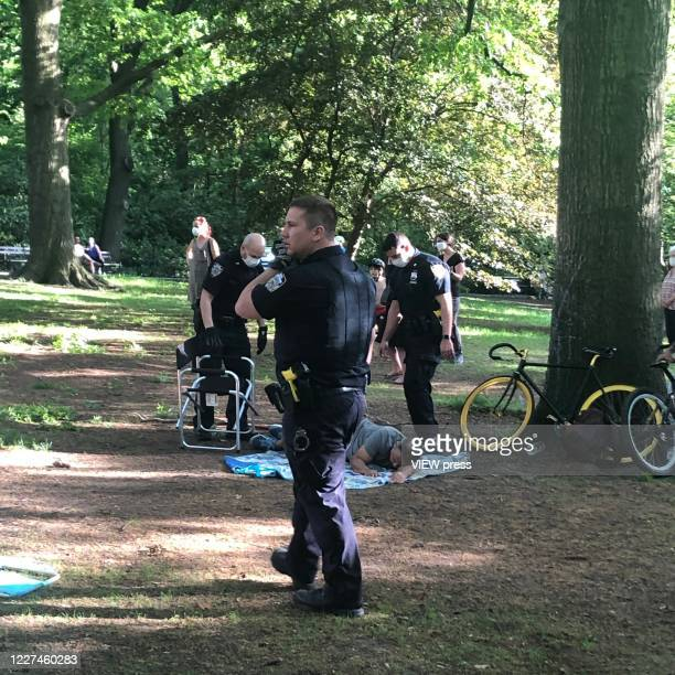 Man who get injured after a branch falls on his is waiting for an ambulance in Riverside Community Park in Upper West Side Manhattan on May 27, 2020...