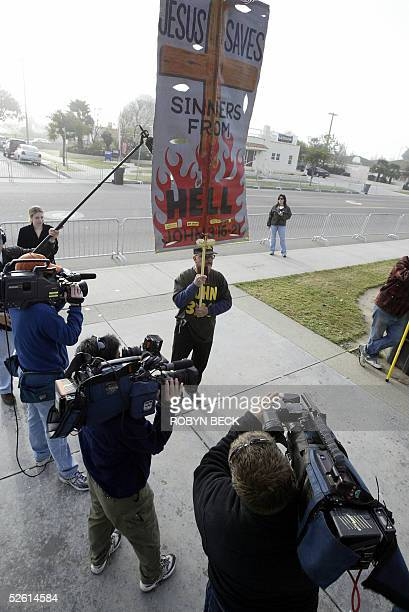 A man who goes by the name Bobby Bible and who was speaking against US pop star Michael Jackson attracts the attention of camermen at the arrival of...