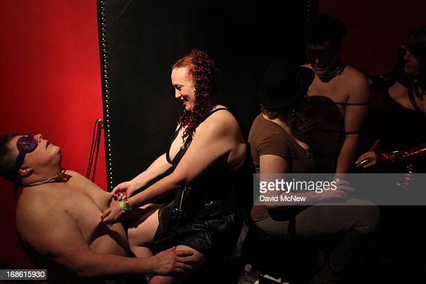 A man who goes by the name MadCubsFan is voluntarily dominated by women at a dungeon party during the domination convention DomConLA in the early...