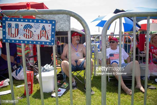 Man who identified himself as David from Tennessee, left, and Kelly Roberts of Kill Devil Hills wait in line to see President Donald Trump Wednesday...