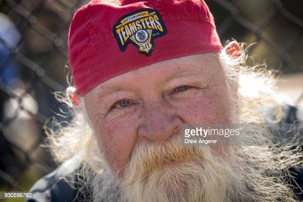 A man who identified himself as 'Uncle Jessie' wears a Teamsters hat as he attends a campaign rally with United Mine Workers of America at the Greene...