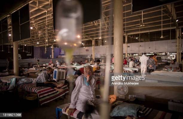 Man who is Covid-19 coronavirus positive wears a Oxygen mask and breathes inside a Covid Care center set up by a charitable institution with support...