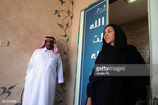 A man who is the guard of the school watches Saudi women arrive at a polling station to vote for the municipal elections on December 12 2015 in...