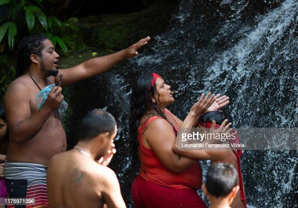 A man who is trance by a spirit of a viking warrior is helped by your spiritual guide during a spiritual ritual inside the well of the mediums in the...
