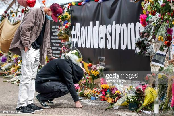 Man who knew shooting victim Neven Stanisic reacts as he arrives at a makeshift memorial outside a King Soopers grocery store on March 25, 2021 in...