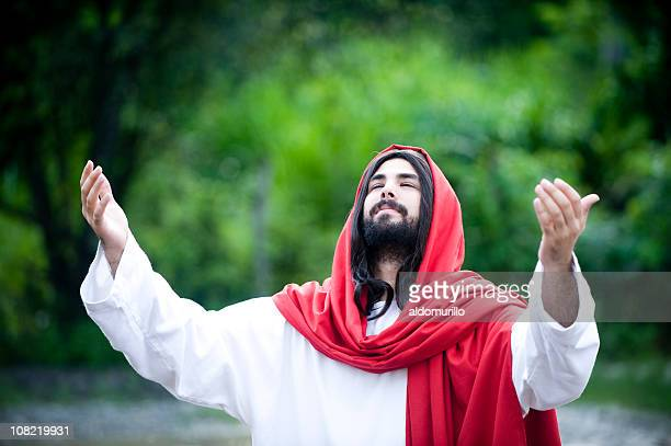 man who looks like jesus christ praying outside - the god father stock photos and pictures
