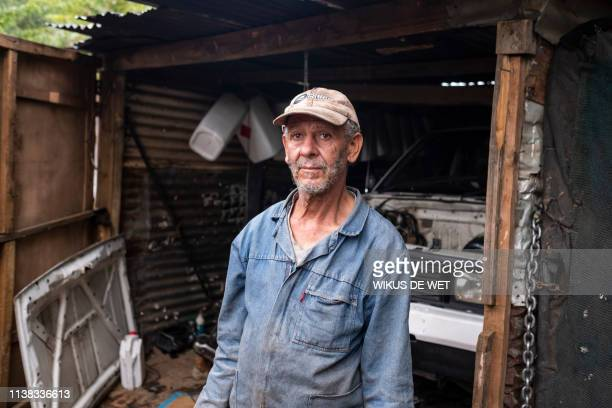 A man who only gave his name as Peter who is a mechanic poses on April 5 2019 in Kliptown near Soweto South Africa goes to the polls next month the...
