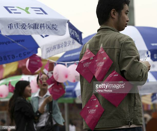 A man who posted information notes on his back waits to make friends during a matchmaking activity to mark the Singles Day November 11 2006 in...