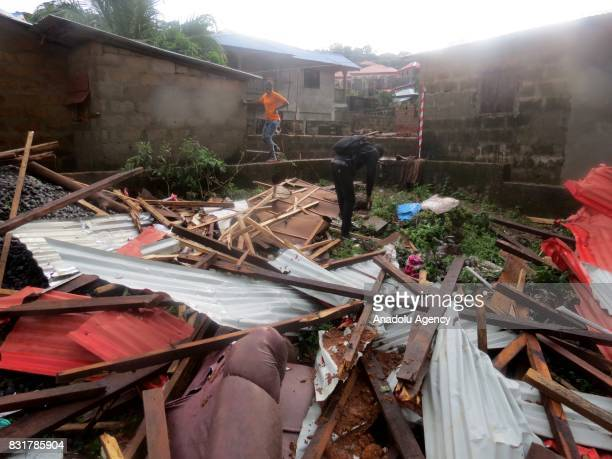A man who survived from the landslide packs his stuff from the wreckage at Regent region of Freetown after landslide struck the capital of the west...