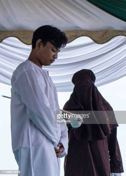 A man who violated Islamic law was whipped at a stadium in Lhokseumawe Aceh Indonesia on Wednesday July 31 2019 Three people violating Islamic law...