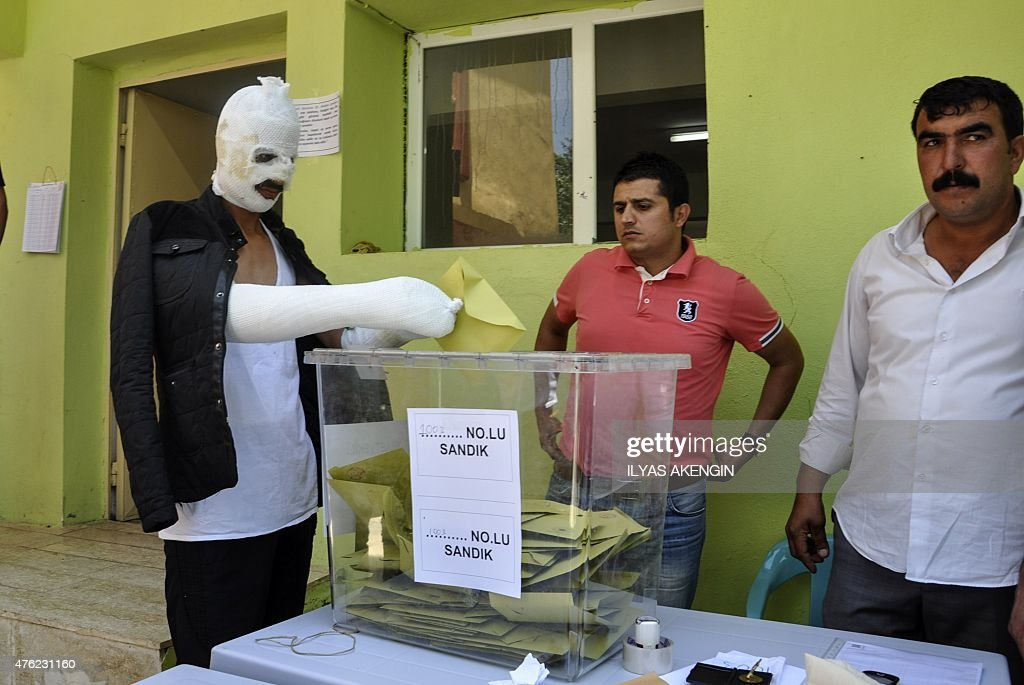 A man who was wounded during the pro-Kurdish People's Democratic Party HDP rally's attack on June 5, casts his vote on June 7, 2015 in the southeastern city of Diyarbakir. The attack in Diyarbakir on June 5 killed two, left dozens more wounded and added to already simmering tensions ahead of June 7 tight legislative polls.