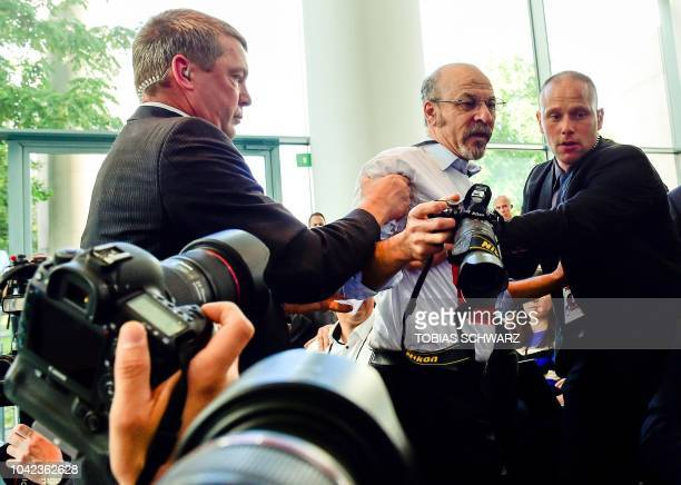 A man who wears a shirt reading Freedom for journalists Freedom of the press for journalists in Turkey during a joint press conference of the German...
