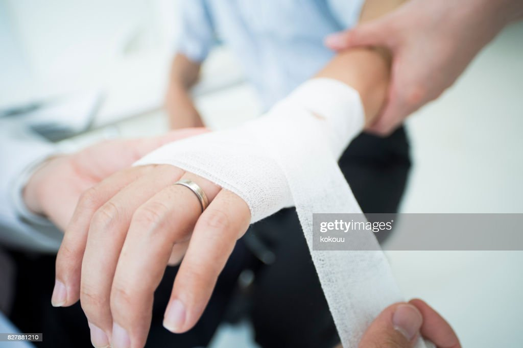 A man who wore a wedding ring got a doctor to receive an allowance for injury. : Stock Photo
