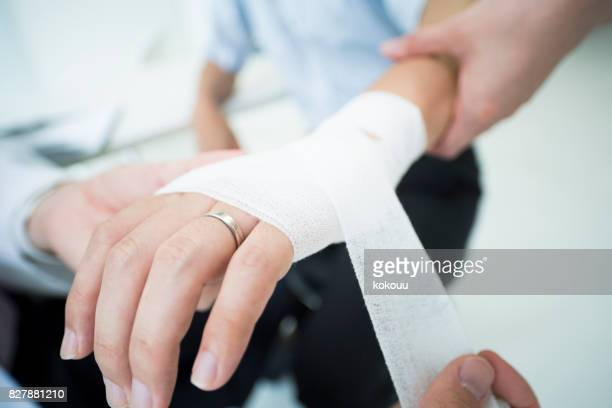 a man who wore a wedding ring got a doctor to receive an allowance for injury. - cut on finger stock photos and pictures