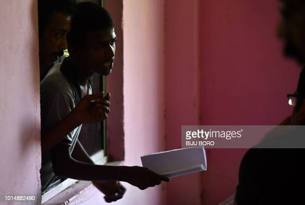 A man whose names is left out in the National Register of Citizens draft stands in a queue to collect forms to file appeals at a NRC Sewa Kendra in...