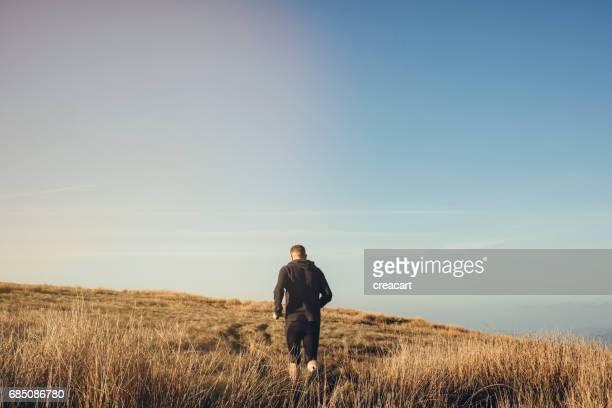 man fell running bright sunny day
