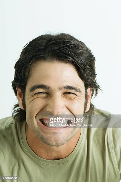 Man wincing, portrait