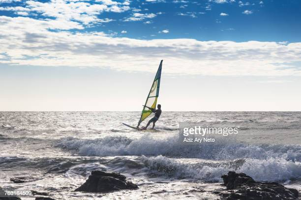 man windsurfing in sea, jericoacoara national park, ceara, brazil - windsurfing stock pictures, royalty-free photos & images