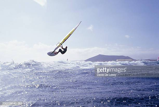 man windsurfing - windsurfing stock pictures, royalty-free photos & images